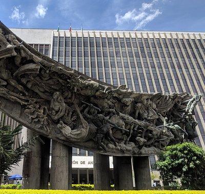 El Monument a La Raza monument against the Government of Antioquia main building.