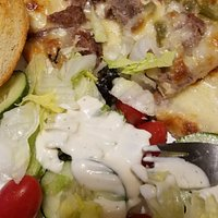 Philly cheesesteak and a side salad