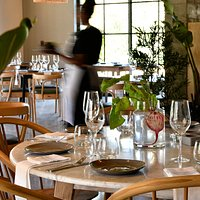 Marble topped tables and handmade wooden chairs from local South African suppliers make for a beautiful dining experience.