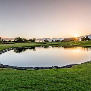 Sunrise over our Clubhouse and 18th green