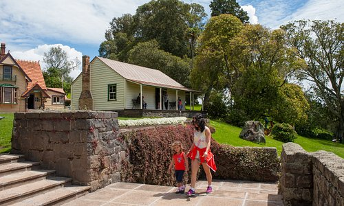 Huia Lodge (left) and Acacia Cottage at Cornwall Park.
