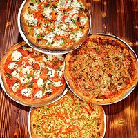 Handmade artisan wood-fired pizzas are one of our specialties!