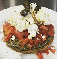 Wholewheat rusk with caper pesto,tomato and goat cheese