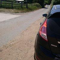 Narrow lane, little parking opportunity, over bridge  to museum (when open)