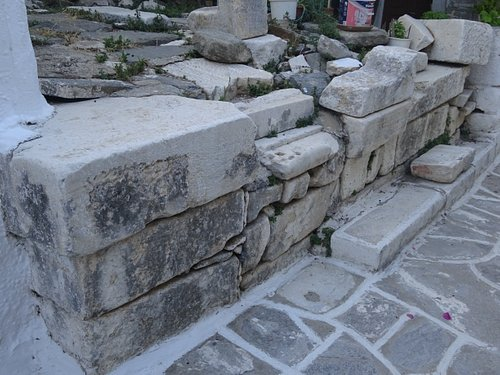 Marbles from the Archaic Temple of Athena are scattered around the Frankish Castle of Parikia - Paros, Greece