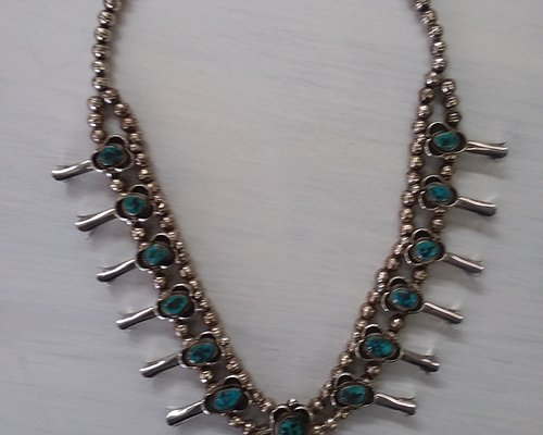 RARE and never worn...come on in and we will tell you all about this piece of genuine turquoise and sterling silver.