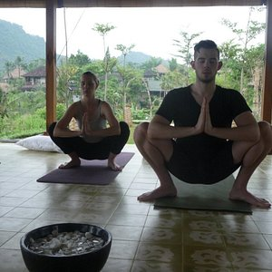 Practicing yoga in our open-air yoga platform in the gorgeous valleys of Sideman, Bali.