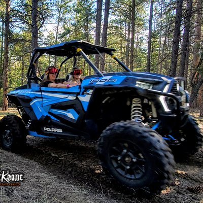 Mom and daughter riding a Polaris RZR 1000 XP with Ride Command in early April 2020.