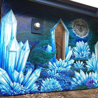 Installed in 2019, our custom designed mural at Crystal Cabin celebrates our passion for Haida Art & Crystals. Artwork by local artist Thomas Arnatt & Haida artist Kwiaahwah Jones.