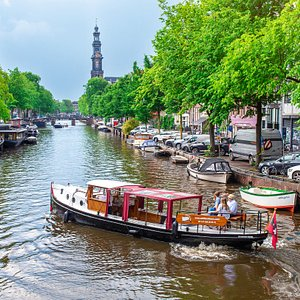 Picture of our boat with the famous Westerkerk in the back