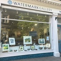 The main shop window at Watermark Gallery Harrogate. We sell a full range of original paintings, limited edition prints, children's book illustration, contemporary jewellery, sculpture and glass.