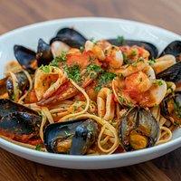 Linguine Adriatica, assorted seafood and shell fish, San Marzano tomato, white wine and garlic.