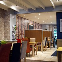 The Restaurant with Covid-19 safety measures in place and social distance screens