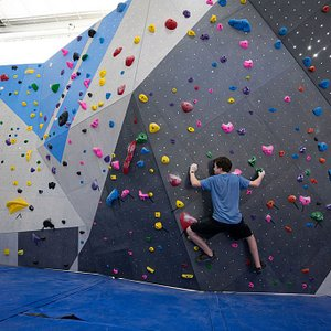 A student working on his traverse skills on our new boulder wall