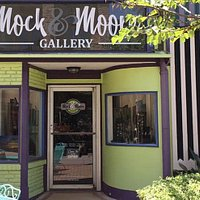 Mock & Moore Gallery storefront, 2215 Postoffice St. featuring original oil paintings by Shawne Moore and handcrafted sterling silver jewelry with unique stones by Karla Mock.