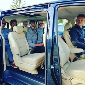 Guests on board our comfortable and exclusive vehicle.  Our Elite model iMax has leather seats, sunroof and expansive window for viewing .