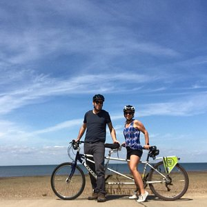 Tandem cycling along the seaside.