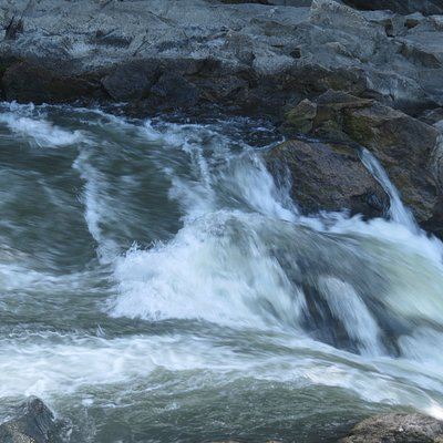 Presumpscot River Falls are visible from the riverside trail at Presumpscot River Preserve in Portland, Maine.