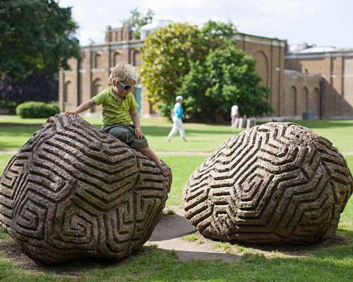 A visit to Dulwich Picture Gallery's gardens provides a great opportunity to explore art and architecture in one setting. See Peter Randall Page's outdoor sculpture Walking the Dog (pictured in the foreground above). Carved out of granite, the design echoes the frieze on the Gallery exterior. Why not also take a moment to appreciate the intricate patterns, lines and shadows of our iconic building, designed by late-Georgian architect Sir John Soane?