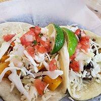 Taco Bus Offerings - Blackened seafood burrito, tamarind soda, marinated pork taco, and butternut squash and portobello mushroom tacos. 🌯🌮