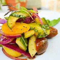 Cucumber and heirloom cherry tomato salad, balsamic vinaigrette with basil chiffonade