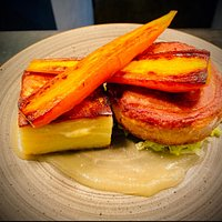 Braised Pork Belly with Dauphinoise Potatoes, Savoy Cabbage, Glazed Carrots, Apple Sauce & Cider Cream