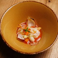 Ceviche with fermented tomato sauce