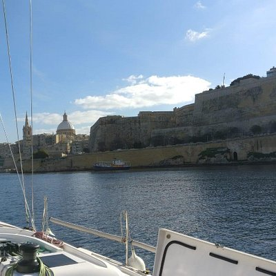 Sailing day trip with Valletta backdrop.