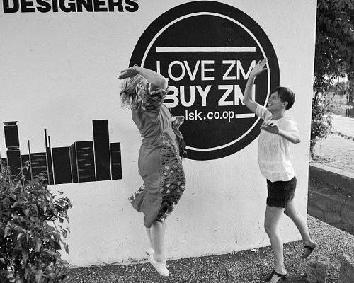 Fun at the inspiring art wall : LOVE ZM , BUY ZM