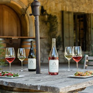 Aromas of French lavender and rosemary greet guests as they approach our winery's our inviting courtyards, leading to the expansive picnic grounds and the gorgeous stone tasting room and barrel aging caves, recalling rustic homes and barns of the Provencal countryside.