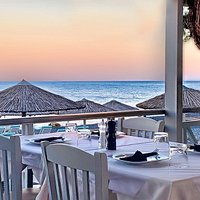 Your Table in our beach-front restaurant in Kamari Beach Santorini - Ariale Restaurant. You can enjoy a special dining experience or a great selection of Wines, drinks and snacks just a few steps away from the famous KAMARI BEACH in Santorini island
