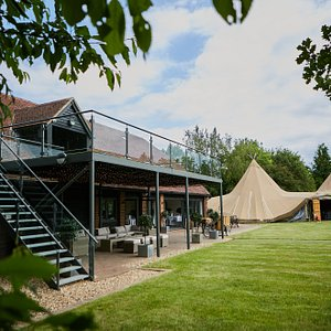 Connected to The Barn are two interlocking tipis. The sides of The Tipis can be lifted, revealing impressive views of the gardens and creating an extended magical space.