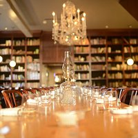 Experience our unique atmosphere, beautiful bar from the late 1800s, floor to ceiling bookshelves and our 30ft community table with antique chandeliers hanging above.