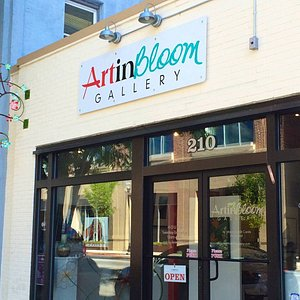 Art in Bloom Gallery is located at 210 Princess Street in the heart of historic downtown Wilmington, NC.  The building was renovated in 2015, and visitors can see the barn walls from 1892 and heart-pine ceiling form 1910 discovered and preserved during the renovation.  The gallery presents an electic mix of original art by emerging and established artists.