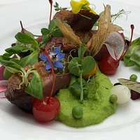 Duck breast with pea puree and forest fruits sauce