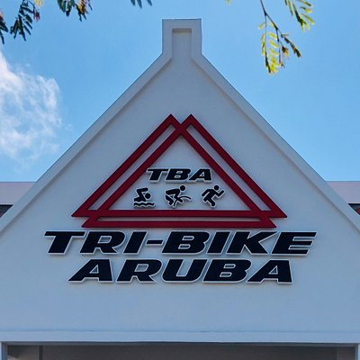 Logo sign at the entrance of TRI-BIKE ARUBA