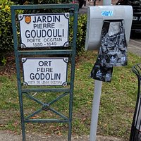 Sign for Jardin Pierre Goudouli near Stone plinth for Poet and story and teller Paul-Armand Silvestre.