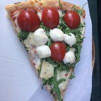 Mister Oregano delicious pizza slice