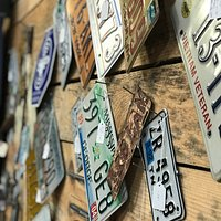 Industrial decor is trending and what better way to document your travels with a wall display of your favorite travel photos mixed in with these vintage license plates?