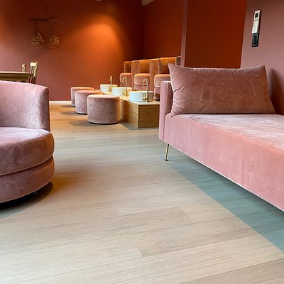Relax in our mani-pedi lounge and relax area designed for a tranquil experience