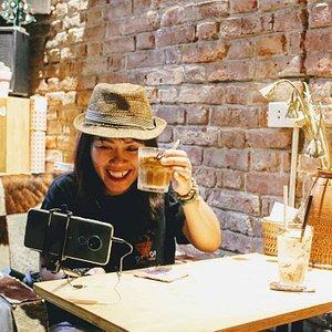 Nikita is showing the Cafe sua da