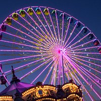 Brights lights of the Broadway 360 Observation Wheel and the carousel.