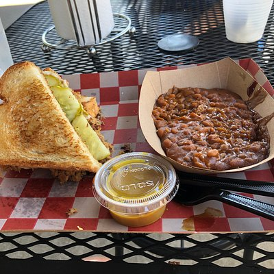 Pulled pork on Texas toast with a side of baked beans.