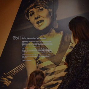 A mother and daughter holding hands in our music Exhibition.