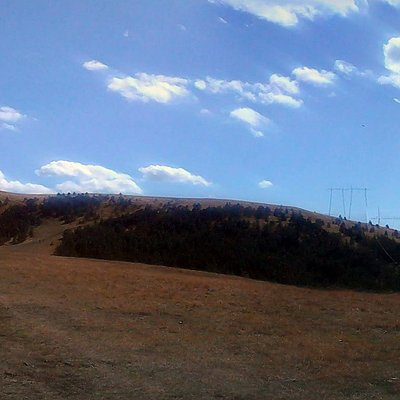 The view uphill from the plateau, with Čuker dominating the scene.