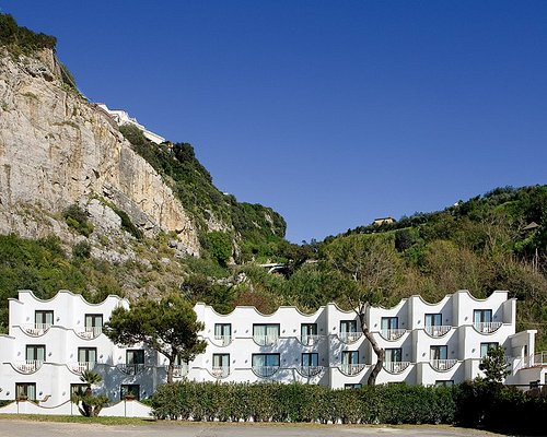 The recently redesigned Conca Azzurra Resort in Massa Lubrense is a top Sorrento and Amalfi Coast resort. Our property overlooks lush grounds, the mineral sea rock beach and turquoise Mediterranean waters.