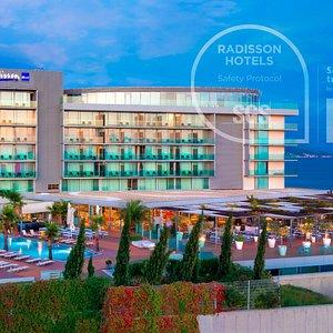 The exterior of Radisson Blu Resort & Spa, Split: outdoor swimming pool, main hotel building, terrace, sea view.