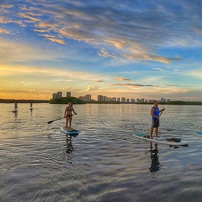 Enjoying a beautiful summertime Sunset SUP Adventure of the Lake Worth Lagoon in North Palm Beach.  Singer Island Florida