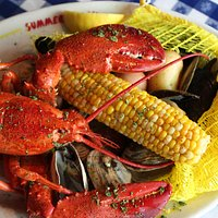 Clam Bake, served with 1lb lobster, mussels, clams, corn, potato, egg & chorizo