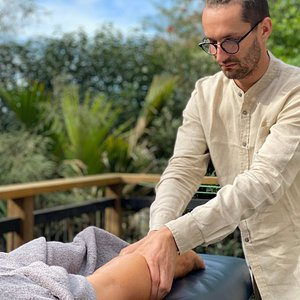 A Full Body Massage on the Deck of the Cottage.